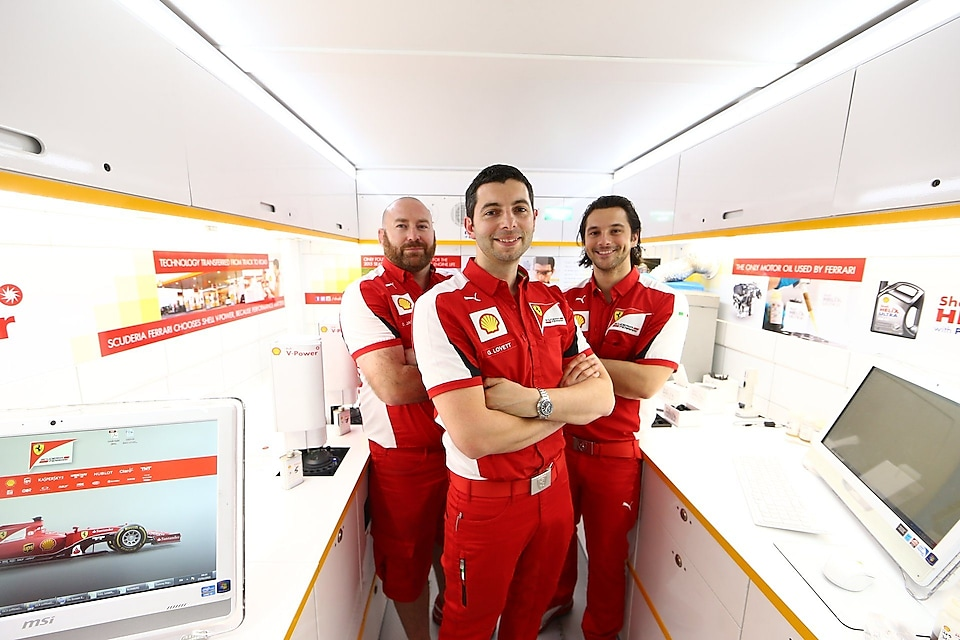 Formula 1 drivers standing in Shell's Track Lab